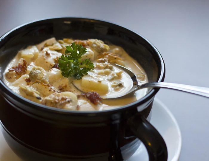 Creamy New England Clam Chowder garnished with parsley