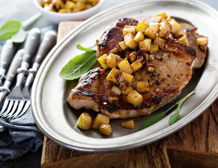 Sauteed pork chops with caramelized apples and walnuts
