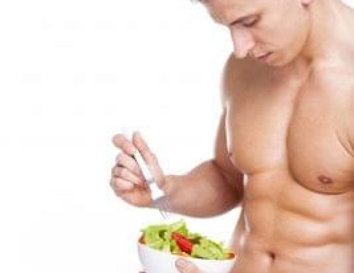 Young-fitness-man-holding-a-bowl-of-salad