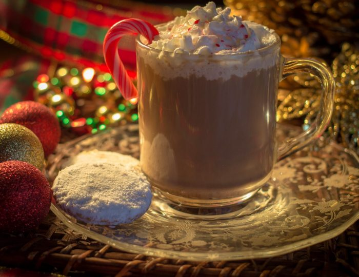 Peppermint Latte. Hot cup of peppermint latte surrounded by holiday decor.