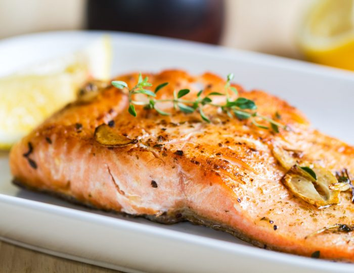 Grilled Salmon with garlic and herb by lemon